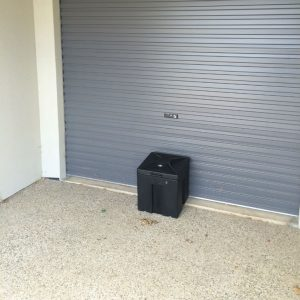secure parcel delivery box at garage roller door